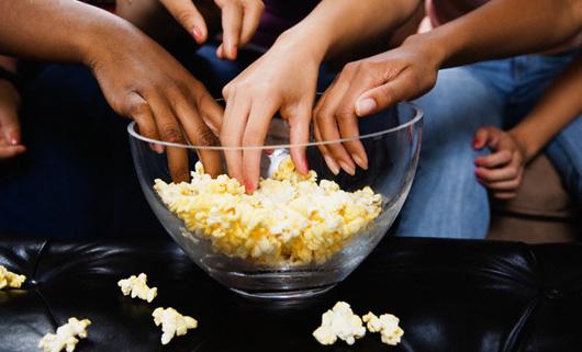 Teenage Girls Eating Popcorn